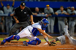 Florida Gators catcher Mike Rivera can't hold on to the throw as a South Carolina base runner slides into home.  Florida Gators Baseball vs South Carolina Gamecocks.  April 10th, 2015. Gator Country photo by David Bowie.