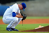 Florida Gators pitcher Logan Shore crouches down prior to taking the mound.  Florida Gators Baseball vs South Carolina Gamecocks.  April 10th, 2015. Gator Country photo by David Bowie.