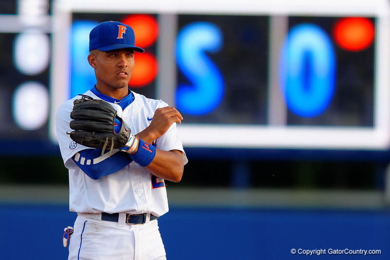 Florida Gators shortstop Richie Martin signals to the plate during the first inning.  Florida Gators Baseball vs South Carolina Gamecocks.  April 10th, 2015. Gator Country photo by David Bowie.