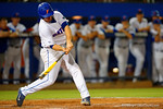 Florida Gators infielder Peter Alonso singles.  Florida Gators Baseball vs South Carolina Gamecocks.  April 10th, 2015. Gator Country photo by David Bowie.