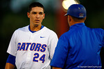 Florida Gators 1B/OF Jeremy Vasquez gets coached up by third base coach Craig Bell.  Florida Gators Baseball vs South Carolina Gamecocks.  April 10th, 2015. Gator Country photo by David Bowie.