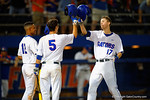 Florida Gators shortstop Richie Martin and Florida Gators infielder Dalton Guthrie wait at the plate to congratulate Florida Gators infielder Christian Hicks as Hicks crosses home after hitting a home run.  Florida Gators Baseball vs South Carolina Gamecocks.  April 10th, 2015. Gator Country photo by David Bowie.