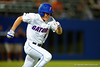 Florida Gators outfielder Harrison Bader swings and drives the ball for a single.  Florida Gators Baseball vs South Carolina Gamecocks.  April 10th, 2015. Gator Country photo by David Bowie.