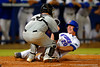 Florida Gators infielder Peter Alonso slides into home nut is tagged out.  Florida Gators Baseball vs South Carolina Gamecocks.  April 10th, 2015. Gator Country photo by David Bowie.