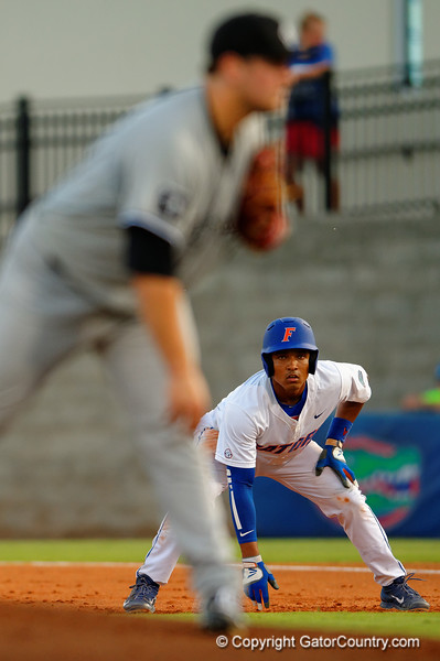 Florida Gators shortstop Richie Martin leads off from first base either the South Carolina pitcher.  Florida Gators Baseball vs South Carolina Gamecocks.  April 10th, 2015. Gator Country photo by David Bowie.