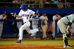 Florida Gators infielder Dalton Guthrie leaps through the air and onto home plate.  Florida Gators Baseball vs South Carolina Gamecocks.  April 10th, 2015. Gator Country photo by David Bowie.