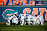 The Gators gather in the outfield prior to the first pitch.  Florida Gators Baseball vs South Carolina Gamecocks.  April 10th, 2015. Gator Country photo by David Bowie.