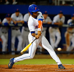 Florida Gators outfielder Buddy Reed swings and singles in the fifth.  Florida Gators Baseball vs South Carolina Gamecocks.  April 10th, 2015. Gator Country photo by David Bowie.