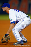 Florida Gators infielder Peter Alonso gets set at first for a pitch.  Florida Gators Baseball vs South Carolina Gamecocks.  April 10th, 2015. Gator Country photo by David Bowie.