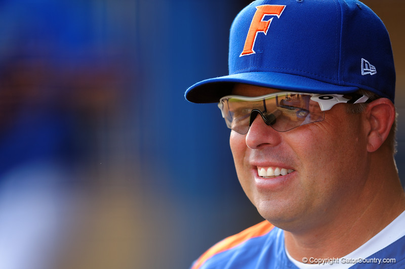 Florida Gators head coach Kevin O'Sullivan looks on from the dugout prior to the start of the game.  Florida Gators Baseball vs South Carolina Gamecocks.  April 10th, 2015. Gator Country photo by David Bowie.