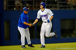 Florida Gators infielder Christian Hicks gets a shake from coach Buddy Bell as he rounds third base after hitting a home run.  Florida Gators Baseball vs South Carolina Gamecocks.  April 10th, 2015. Gator Country photo by David Bowie.