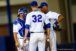 Florida Gators catcher Mike Rivera and Florida Gators shortstop Richie Martin come out to calm down Florida Gators pitcher Logan Shore.  Florida Gators Baseball vs South Carolina Gamecocks.  April 10th, 2015. Gator Country photo by David Bowie.