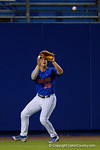 Florida Gators outfielder Danny Reyes eyes a fly ball into his glove, as the No. 1 overall seed Florida Gators conclude their opening sweep of the Gainesville Regional by beating Georgia Tech 10-1 in the final at McKethan Stadium.  June 5th, 2016. Gator Country photo by David Bowie.