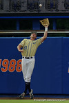 Georgia Tech outfielder Brandt Stallings leaps into the air at the track for an out, as the No. 1 overall seed Florida Gators conclude their opening sweep of the Gainesville Regional by beating Georgia Tech 10-1 in the final at McKethan Stadium.  June 5th, 2016. Gator Country photo by David Bowie.