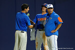 Florida Gators head coach Kevin O'Sullivan and a Gators trainer elbow of Florida Gators third baseman Jonathan India after India was hit by a pitch, as the No. 1 overall seed Florida Gators conclude their opening sweep of the Gainesville Regional by beating Georgia Tech 10-1 in the final at McKethan Stadium.  June 5th, 2016. Gator Country photo by David Bowie.