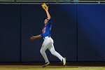 Florida Gators outfielder Danny Reyes leaps for a fly ball and makes the catch, as the No. 1 overall seed Florida Gators conclude their opening sweep of the Gainesville Regional by beating Georgia Tech 10-1 in the final at McKethan Stadium.  June 5th, 2016. Gator Country photo by David Bowie.