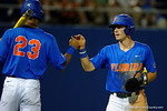Florida Gators third baseman Jonathan India is congratulated by Florida Gators outfielder Buddy Reed after scoring, as the No. 1 overall seed Florida Gators conclude their opening sweep of the Gainesville Regional by beating Georgia Tech 10-1 in the final at McKethan Stadium.  June 5th, 2016. Gator Country photo by David Bowie.