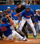 Florida Gators outfielder Buddy Reed directing Florida Gators first baseman Peter Alonso to the plate, as the No. 1 overall seed Florida Gators conclude their opening sweep of the Gainesville Regional by beating Georgia Tech 10-1 in the final at McKethan Stadium.  June 5th, 2016. Gator Country photo by David Bowie.