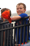 A young Gators fan is all smiles as he gets a hat signed, as the No. 1 overall seed Florida Gators conclude their opening sweep of the Gainesville Regional by beating Georgia Tech 10-1 in the final at McKethan Stadium.  June 5th, 2016. Gator Country photo by David Bowie.