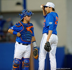 Florida Gators catcher Mike Rivera comes out to talk with Florida Gators pitcher Alex Faedo as the No. 1 overall seed Florida Gators conclude their opening sweep of the Gainesville Regional by beating Georgia Tech 10-1 in the final at McKethan Stadium.  June 5th, 2016. Gator Country photo by David Bowie.