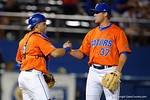 Florida Gators catcher Mike Rivera comes out to congratulate Florida Gators pitcher Shaun Anderson as the #1 ranked Gators chomp the #11 Florida State Seminoles 6-0 at McKethan Stadium. March 15th, 2015. Gator Country photo by David Bowie.