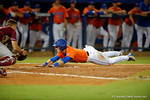 Florida Gators shortstop Dalton Guthrie slides into home as the #1 ranked Gators chomp the #11 Florida State Seminoles 6-0 at McKethan Stadium. March 15th, 2015. Gator Country photo by David Bowie.