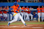Florida Gators catcher JJ Schwarz singles as the #1 ranked Gators chomp the #11 Florida State Seminoles 6-0 at McKethan Stadium. March 15th, 2015. Gator Country photo by David Bowie.