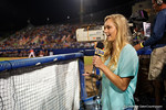 Florida Gators first baseman Taylor Schwarz giving an interview to the SEC Network as her brother,Florida Gators catcher JJ Schwarz, stands at the plate; as the #1 ranked Gators chomp the #11 Florida State Seminoles 6-0 at McKethan Stadium. March 15th, 2015. Gator Country photo by David Bowie.