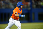 Florida Gators catcher Mike Rivera singles as the #1 ranked Gators chomp the #11 Florida State Seminoles 6-0 at McKethan Stadium. March 15th, 2015. Gator Country photo by David Bowie.