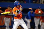 Florida Gators catcher JJ Schwarz swings at a pitch as the #1 ranked Gators chomp the #11 Florida State Seminoles 6-0 at McKethan Stadium. March 15th, 2015. Gator Country photo by David Bowie.
