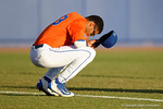Florida Gators outfielder Buddy Reed makes a pre-game prayer as the #1 ranked Gators chomp the #11 Florida State Seminoles 6-0 at McKethan Stadium. March 15th, 2015. Gator Country photo by David Bowie.