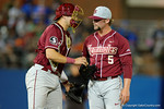 FSU pitcher Matthew Kinney gets some advice from his catcher as the #1 ranked Gators chomp the #11 Florida State Seminoles 6-0 at McKethan Stadium. March 15th, 2015. Gator Country photo by David Bowie.