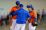 Florida Gators catcher Mike Rivera and head coach Kevin O'Sullivan come out to talk to Florida Gators pitcher Dane Dunning as the #1 ranked Gators chomp the #11 Florida State Seminoles 6-0 at McKethan Stadium. March 15th, 2015. Gator Country photo by David Bowie.