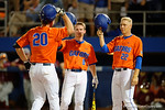 Florida Gators second baseman Deacon Liput and Florida Gators catcher JJ Schwarz wait at home to congratulate Florida Gators first baseman Peter Alonso as the #1 ranked Gators chomp the #11 Florida State Seminoles 6-0 at McKethan Stadium. March 15th, 2015. Gator Country photo by David Bowie.