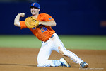 Florida Gators first baseman Peter Alonso dives for a ball and throws to first base as the #1 ranked Gators chomp the #11 Florida State Seminoles 6-0 at McKethan Stadium. March 15th, 2015. Gator Country photo by David Bowie.