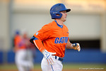 Florida Gators second baseman Deacon Liput trots to first base to extend his record to 19 games straight reaching base, as the #1 ranked Gators chomp the #11 Florida State Seminoles 6-0 at McKethan Stadium. March 15th, 2015. Gator Country photo by David Bowie.
