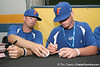Florida junior Josh Adams and freshman catcher Austin Maddox sign autographs during the Gators' pre-College World Series practice on Friday, June 18, 2010 at Rosenblatt Stadium in Omaha, Neb. / photo by Tim Casey