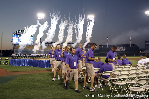 TCU players get seated during the College World Series Opening Ceremonies on Friday, June 18, 2010 at Rosenblatt Stadium in Omaha, Neb. / photo by Tim Casey
