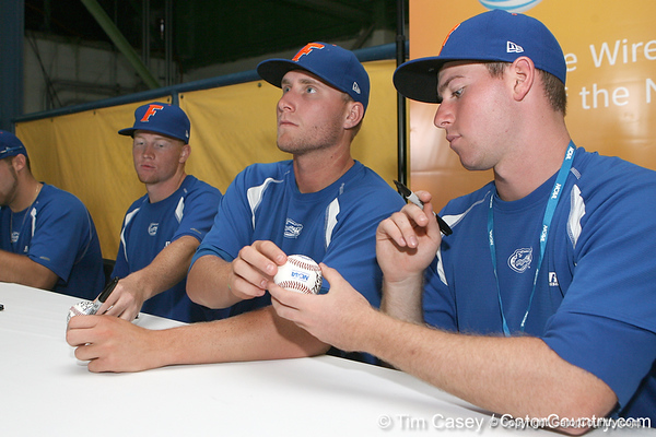 Florida junior pitcher Kevin Chapman and sophomore Anthony DeSclafani sign autographs during the Gators' pre-College World Series practice on Friday, June 18, 2010 at Rosenblatt Stadium in Omaha, Neb. / photo by Tim Casey