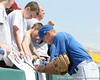 Florida sophomore outfielder Tyler Thompson signs an autograph during the Gators' pre-College World Series practice on Friday, June 18, 2010 at Rosenblatt Stadium in Omaha, Neb. / photo by Tim Casey