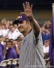 Former LSU coach Skip Bertman waves to fans during the College World Series Opening Ceremonies on Friday, June 18, 2010 at Rosenblatt Stadium in Omaha, Neb. / photo by Tim Casey