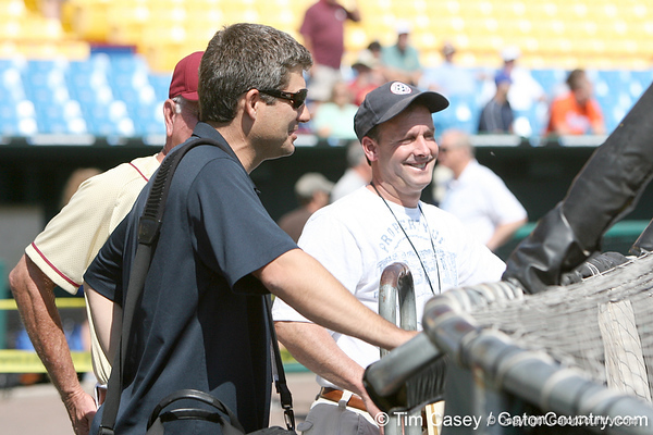 Robin Ventura and Karl Ravech watch during the Gators' pre-College World Series practice on Friday, June 18, 2010 at Rosenblatt Stadium in Omaha, Neb. / photo by Tim Casey