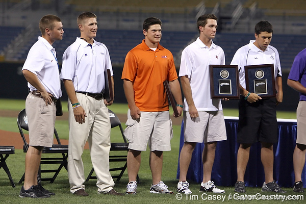 Florida senior catcher Hampton Tignor receives an award for leading the Gators in GPA during the College World Series Opening Ceremonies on Friday, June 18, 2010 at Rosenblatt Stadium in Omaha, Neb. / photo by Tim Casey