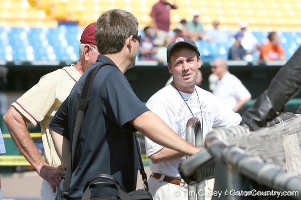 Karl Ravech talks with Robin Ventura during the Gators' pre-College World Series practice on Friday, June 18, 2010 at Rosenblatt Stadium in Omaha, Neb. / photo by Tim Casey
