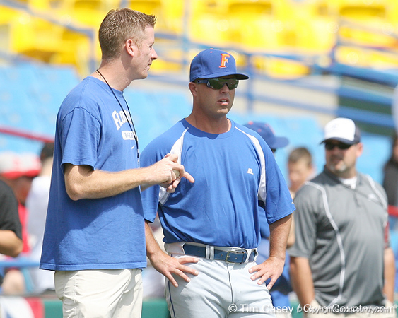 Jeff Cardozo talks with Florida baseball head coach Kevin O'Sullivan during the Gators' pre-College World Series practice on Friday, June 18, 2010 at Rosenblatt Stadium in Omaha, Neb. / photo by Tim Casey