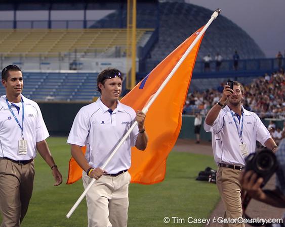 Florida senior Matt den Dekker carried the team flag during the College World Series Opening Ceremonies on Friday, June 18, 2010 at Rosenblatt Stadium in Omaha, Neb. / photo by Tim Casey