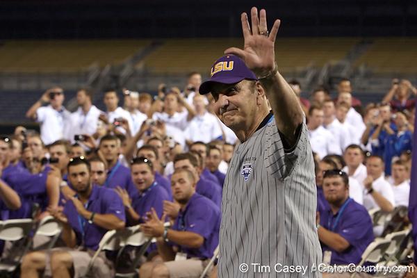 Former LSU coach Skip Bertman waves to fans during the College World Series Opening Ceremonies on Friday, June 18, 2010 at Rosenblatt Stadium in Omaha, Neb. / photo by Tim Casey