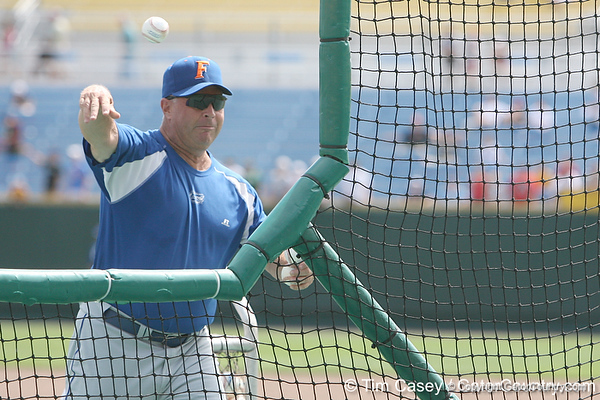 Florida baseball assistant coach Brad Weitzel throws batting practice during the Gators' pre-College World Series practice on Friday, June 18, 2010 at Rosenblatt Stadium in Omaha, Neb. / photo by Tim Casey