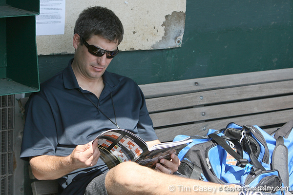 Robin Ventura reads the Florida media guide during the Gators' pre-College World Series practice on Friday, June 18, 2010 at Rosenblatt Stadium in Omaha, Neb. / photo by Tim Casey