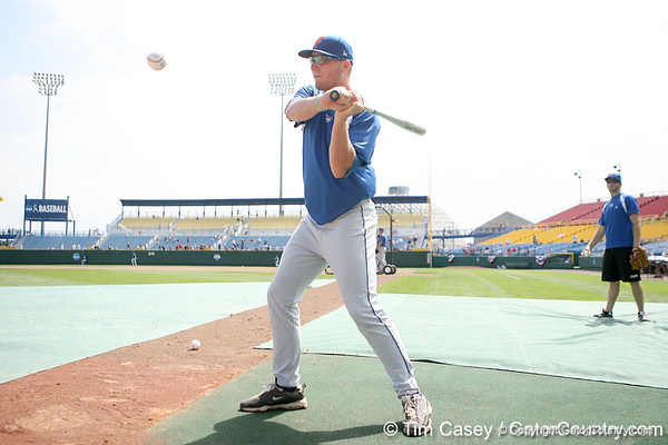 Florida junior pitcher Kevin Chapman hits ground balls during the Gators' pre-College World Series practice on Friday, June 18, 2010 at Rosenblatt Stadium in Omaha, Neb. / photo by Tim Casey